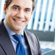 Royalty-Free Stock Photo: Portrait of smiling businessman at office