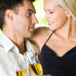 Young happy couple with champagne, outdoor — Stock Photo #14327283