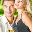 Young happy couple with champagne, outdoor — Stock Photo #14327291