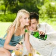 Young happy couple with champagne, outdoor — Stock Photo #14327349