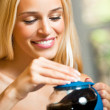 Happy girl with teapot and cup, at home — Stock Photo #14328071