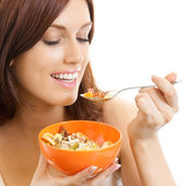Cheerful woman eating muslin, over white — Stock Photo