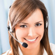 图库照片: Happy smiling support phone operator at office