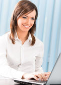 Businesswoman working with laptop — Stock Photo