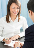 Happy businesspeople, or businesswoman and client — Stock Photo
