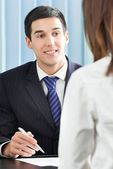 Happy businesspeople or businessman and client — Stock Photo
