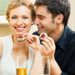 Cheerful couple with champagne — Stock Photo #15321653