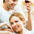 Cheerful couple with glasses of redwine — Stock Photo #15321723
