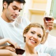 Cheerful couple with glasses of redwine - Foto Stock