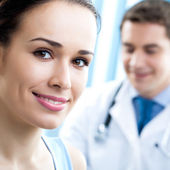 Portrait of smiling doctor and female patient — Stock Photo