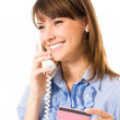 Young happy smiling business woman with plastic card, on phone — Stock Photo #15714531