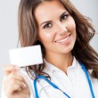 Young female doctor showing blank business card — Stock Photo #15729655