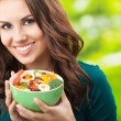 Young woman with salad, outdoors - Stockfoto