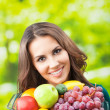 Woman with plate of fruits, outdoors — Stock Photo