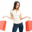 Young happy woman with shopping bags, isolated — Stock Photo #16985733