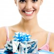 Young smiling woman with gift, isolated — Stock Photo #16986701