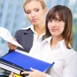 Stock Photo: Businesswomen with documents at office