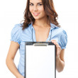 Beautiful young woman showing blank clipboard — Stock Photo