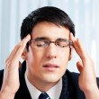 Stock Photo: Thinking, tired or ill with headache businessman