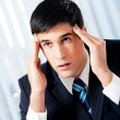 Thinking, tired or ill with headache businessman — Стоковая фотография