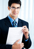 Businessman with document or contract, at office — Stock Photo