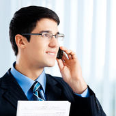 Businessman with documents or contract and phone — Stock Photo