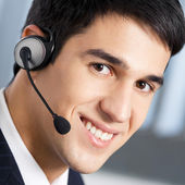 Support phone operator in headset at workplace — Stok fotoğraf