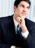 Portrait of thinkihg businessman at office — Stock Photo
