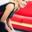 Young woman doing fitness exercise, indoors — Foto de Stock