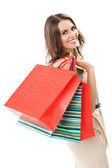 Młoda kobieta szczęśliwa z torby na zakupy, na białym tle — Zdjęcie stockowe