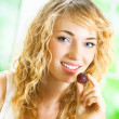 Young happy woman eating grape — Stock Photo