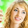 Smiling young woman with perfum bottle — Stock Photo