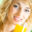 Happy woman drinking juice — Stock Photo #18421367