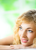 Smiling young beautiful woman, indoors — Stock Photo