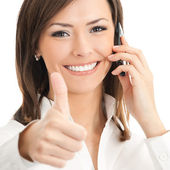Happy smiling successful businesswoman with cell phone and thumb — Stock Photo
