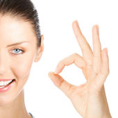 Happy smiling woman with okay gesture, isolated — Stock Photo