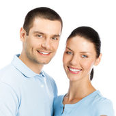 Happy smiling young couple, on white — Stock Photo