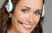 Support phone operator in headset, on gray — Stock Photo