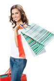 Young happy woman with shopping bags, isolated — Stok fotoğraf