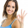Portrait of smiling woman with OK sign, over white — Stock Photo