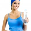 Woman in fitness wear with water, over white — Stock Photo #19139701