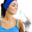 Woman in fitness wear with water, over white — Stock Photo #19139797