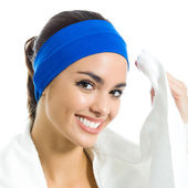 Cheerful woman in fitness wear with towel, over white — Stock Photo