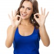 Woman showing okay gesture, isolated — Stock Photo #19325153