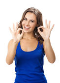 Woman showing okay gesture, isolated — Stock Photo