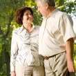 Happy senior couple walking outdoor — Stock Photo