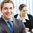 Stock Photo: Portrait of smiling businessman at office
