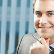 Portrait of smiling businessman at office — Stock Photo #19632329