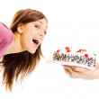 Cheerful woman eating pie, over white — Stock Photo