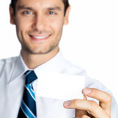 Businessman showing blank business or plastic card — Stock Photo